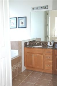 Master bathroom| soaker tub | dual vanity + marble counters | double door entry