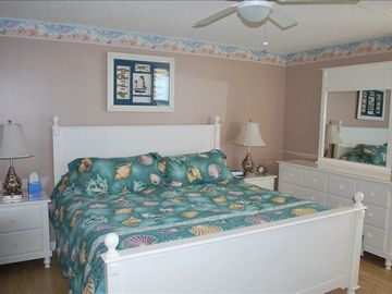 Extremely comfortable King Bed with seashell quilt motif & Pine WOOD floor