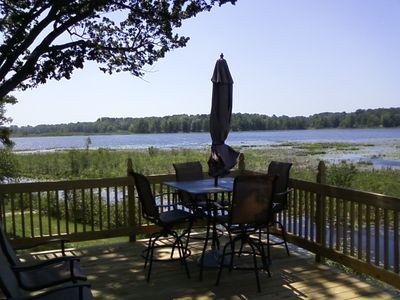 The back deck has a beautiful patio set and overlooks the lake