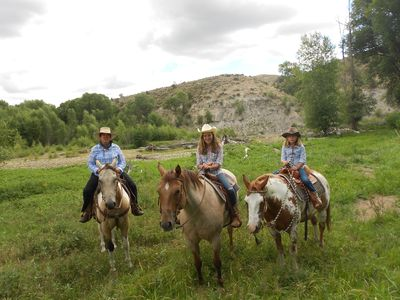 horses and riders along Savery Creek