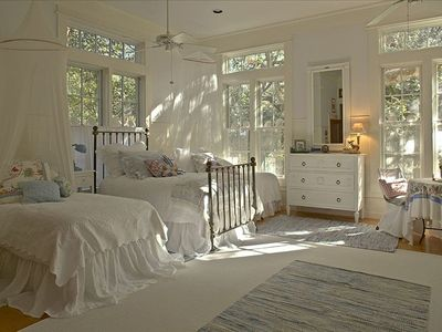 A charming kid's room with 3 twins, bathed in natural sunlight!