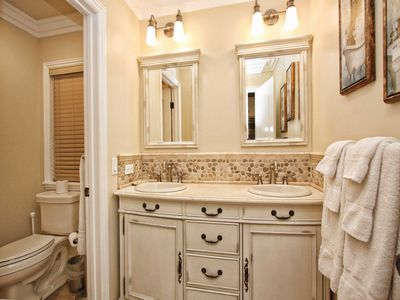 Each Suite has private Bath. Half Bath on Main Level. 2 1/2 Baths total!
