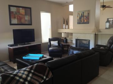Family Room with Fireplace, loads of seating. Adjacent to Kitchen.