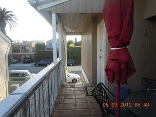 Del Mar condo photo - deck showing stairway to street and entry door