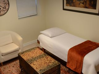 Capitol Hill studio photo - Couch in living room converts to twin bed.