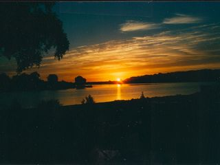 Muskegon house photo - Sun rise over Mona lake from front of house.