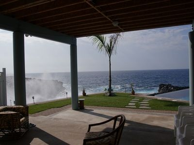 sitting in the pool side living area looking out on the ocean's winter swell