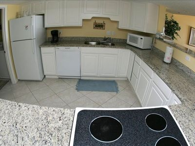 Large full size kitchen including laundry room with washer/dryer
