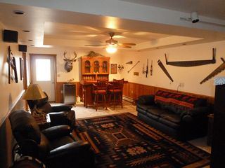 Cody cabin photo - Familiy room in teh Basement, there is a big screen TV and Bar