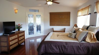 Master Suite - The Master Suite at Hau'oli Hale is bright and there is a TV for night time entertainment.