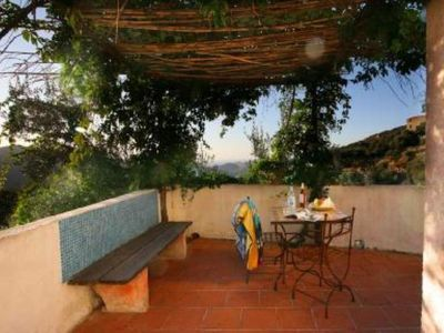Casa Costa. LAMA. Durable and reasoned. Studio, terrace above the olive trees,
