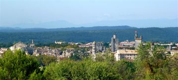 Uzes seen from the east with the Cevennes mountains in the far background