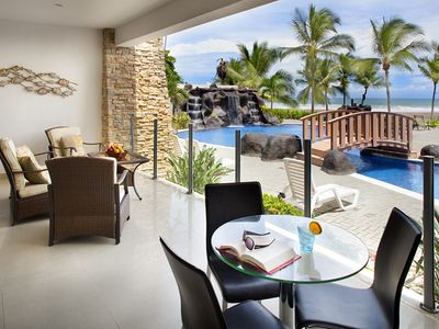 Ample ocean view terrace right in front of the pool
