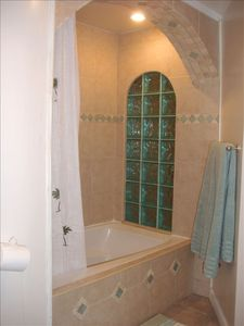 6 jet jacuzzi, and rainfall shower, Morroccan inspired tiling