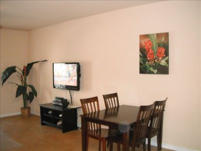 "Living and Diningroom with a 42"" flat pannel TV and DVD player and cable"