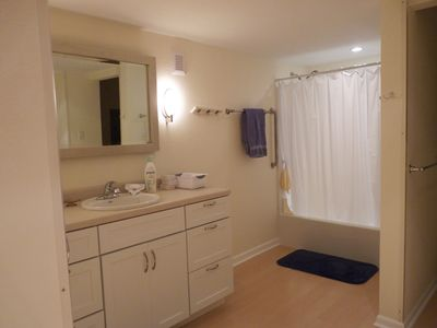 Large bathroom with separate room for toilet