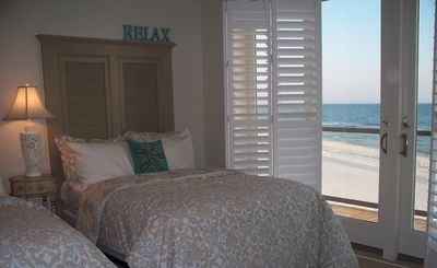 Bedroom #2 has two double beds with balcony/patio and private bath