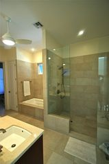 Providenciales - Provo villa photo - Master Bath, walk-in shower, two sinks, and yes there is a bathtub.