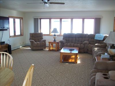 "Upstairs living room has comfy seating, satellite tv and new 46"" tv ."