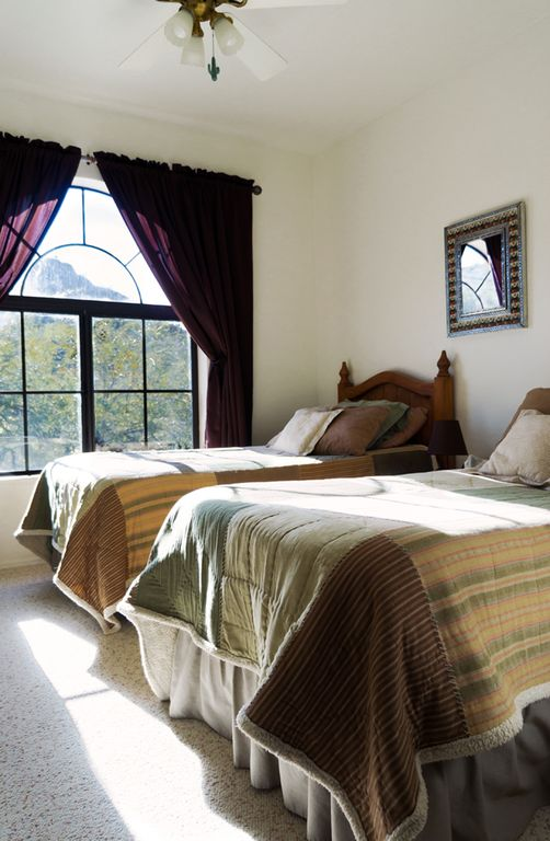 Twin bedroom w/views of mt. preserve and pool. Beds may be converted to king.
