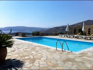 Andros villa photo - General aspect of the pool area with loungers, umbrellas & a hammock