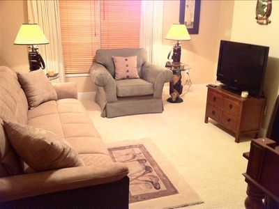 Black house rental - Third bedroom upstairs with reclining couch used as couch.