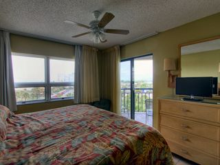 St Pete Beach condo photo - Alternate view of Master Bedroom with view of beach and entrance to balcony.
