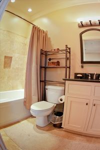 Bathroom 3. Granite countertop and travertine shower surround and floors.