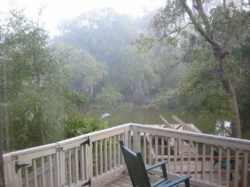 Deck of house overlooking creek with floating dock to crab and fish- baby gate