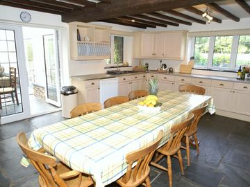 The spacious kitchen leading to the conservatory