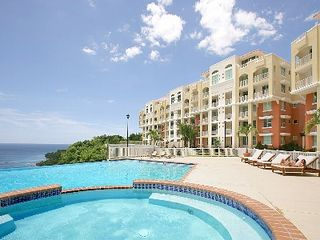 Aguadilla condo photo - Swim in the infinity pool and enjoy the views