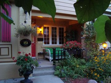 Front entrance, garden and private front porch to watch the people go by.