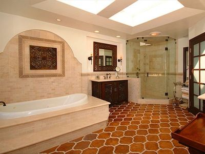 master bath with jetted tub, steam shower, and separate bidet and toilet room.