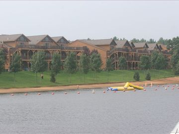Castle Rock Lake condo rental - Sandy beach is steps away from your condo and at night, enjoy sunset from deck.