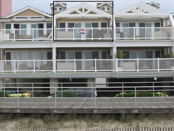 External view from beach with specific top floor condo boxed out.