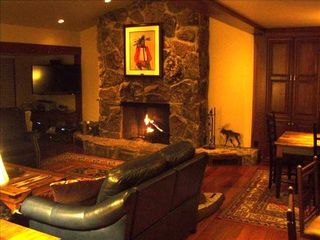 Teton Village condo photo - Living Room With Vaunted Ceiling, Wood Fireplace, and soft Leather Seats