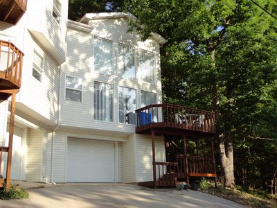 Modern Duplex with the three levels including garage, and patio deck.