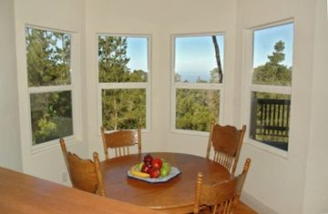 Breakfast nook off the kitchen has an ocean view