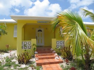 Road side entrance to Sunnyside Beach Villa - cheery yellow with white shutters - Spanish Wells villa vacation rental photo