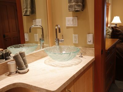 Granite countertop in master bathroom with heated slate floors.