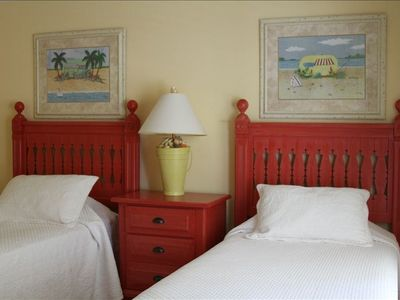 Two twin beds with bright, colorful decor in second bedroom, with its own TV!