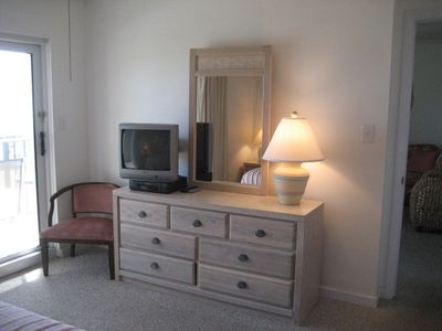 Master Bedroom - Dresser and Door to Patio. Now featuring flat screen TVs.