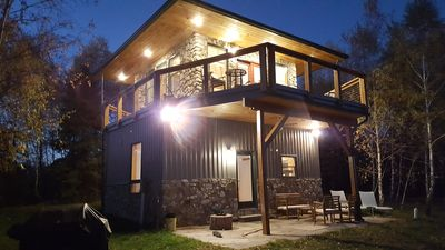 Modern firetower 2 story chalet with majestic views located 70+ private acres.