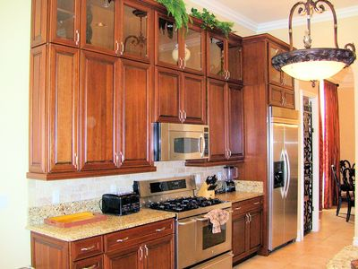 Tall Kitchen cabinets really accent this oversized kitchen
