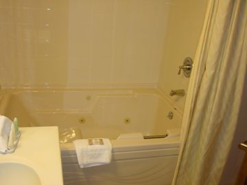 Large Bathroom with Whirlpool Bath and shower
