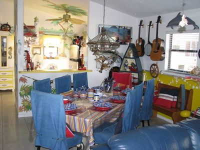 #1 Beach house- enjoy your meals with color and festive furnishings.