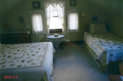 Bedroom with a twin bed and queen size bed