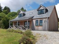Charming property overlooking beach at Knock Bay and beyond to Knoydart