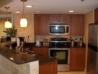 Palmetto Dunes condo photo - Granite counter tops & stainless steel appliances. Breakfast bar is to the left