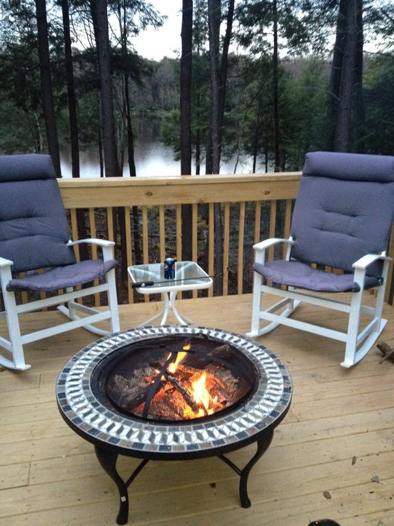 Firepit and rocking chairs on deck